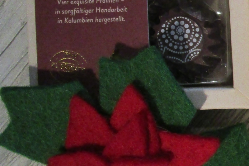 Pralinenmischung Amanos weihnachtlich dekoriert - Weltladen Soltau